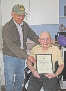 Virgil E. Hoelscher receiving 70 yrs of American Legion Member from Clarence Gogolek C.jpg