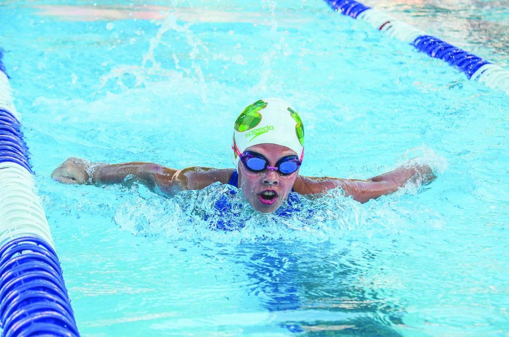 Rylee Habbe swims during the Blue Racers meet with Red Bud on July 3.