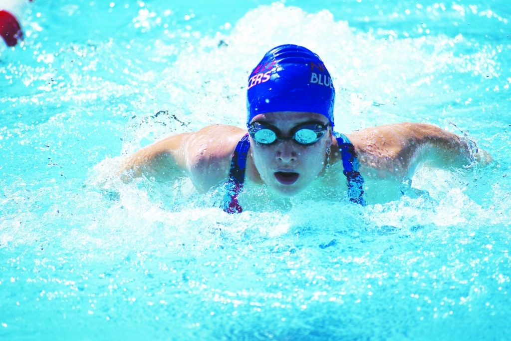 Olivia Anderson swims during the Shawnee Conference Meet on July 20. RIGHT: Gabe Kreid swims at the conference meet.