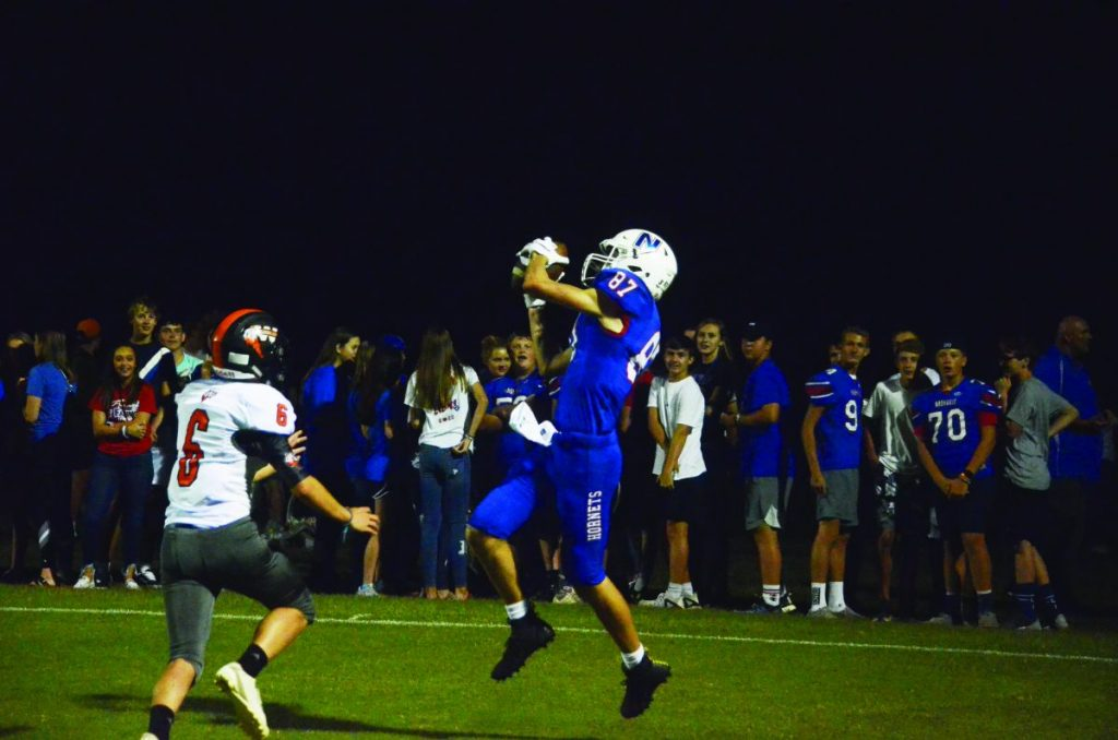 Jaxon Goforth goes up for the touchdown catch in the second quarter of the Hornets 47-6 win over Wesclin on September 13.