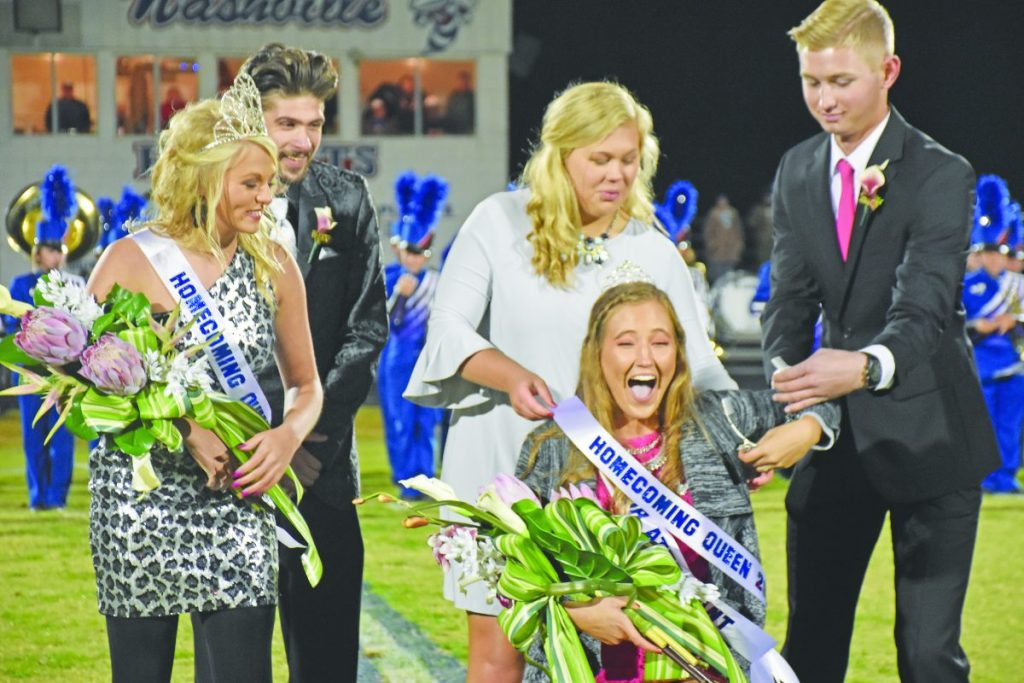 Sarah Staley, center, is all smiles as she is crowned during a coronation ceremony Friday night as the 2019 Homecoming Queen.