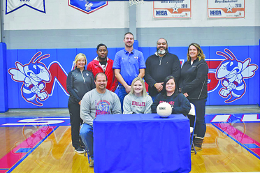 Pictured (bottom, left to right): Brian Wesselman, Abby Wesselman, Jamie Wesselman, (top right to left) Coach Autumn Konkel, Andre Irizarry (Club Volletball Coach), NCHS Head Coach Josh Konkel, Reggie Bateman (Rend Lake Head Coach), and NCHS Athletic Director Alicia Heggemeier.