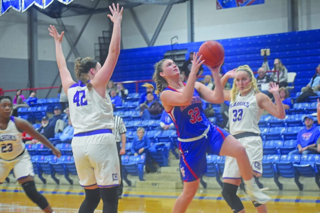 Alyssa Cole drives to the hoop during the Nashville-Collinsville game.