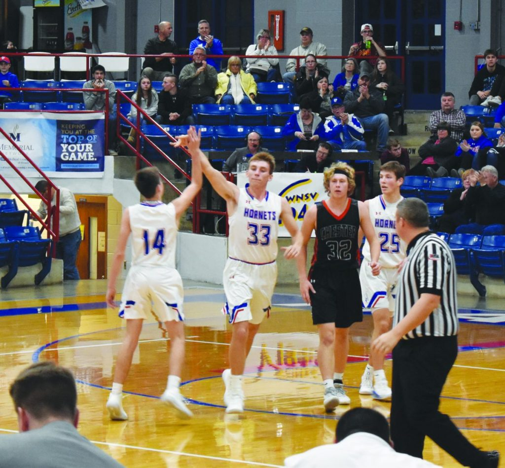Above: Terry Pelczynski (33) celebrates with Buzz Ritzel (14) after burying a three pointer at the buzzer at the end of the third quarter in Tuesday night's victory.