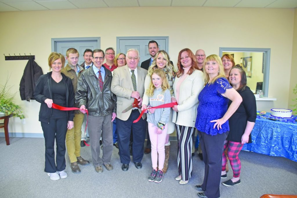 Members of the Nashville Chamber of Commerce and employees of Skin Care Center of Southern Ilinois celebrate a ribbon cutting ceremony with Mayor Raymond Kolweier on Monday, January 20. The new location in the downtown area offers medical, surgical and cosmetic dermatology services.