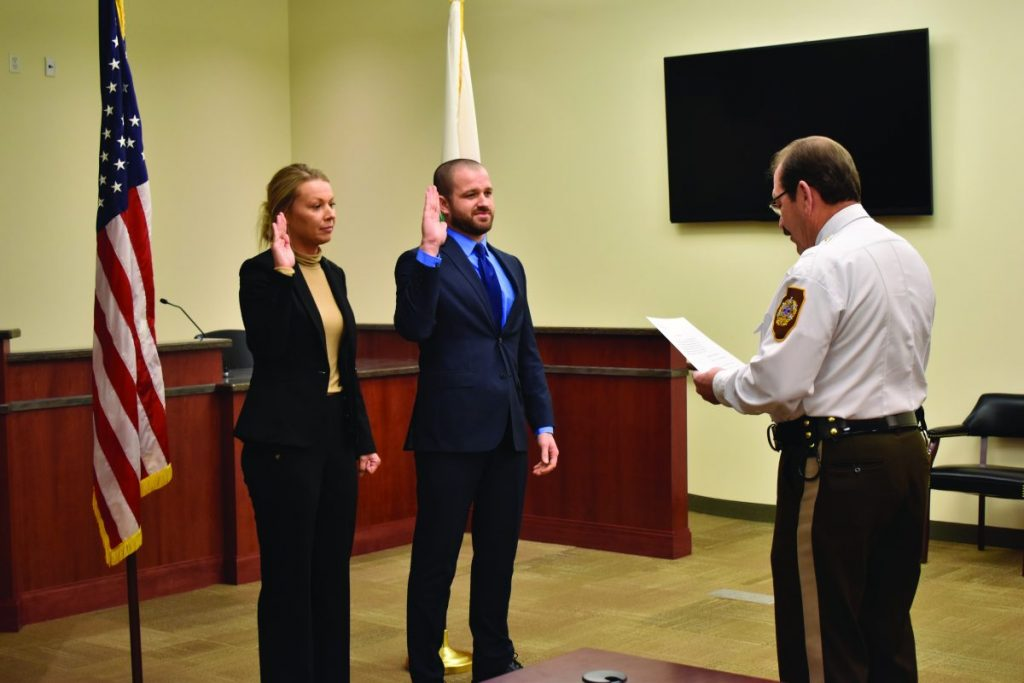 Washington County Sheriff Len Campbell swears in Roxanne Styninger and Eban Lisk as deputies on Friday, February 7, at the Washington County Judicial Center.