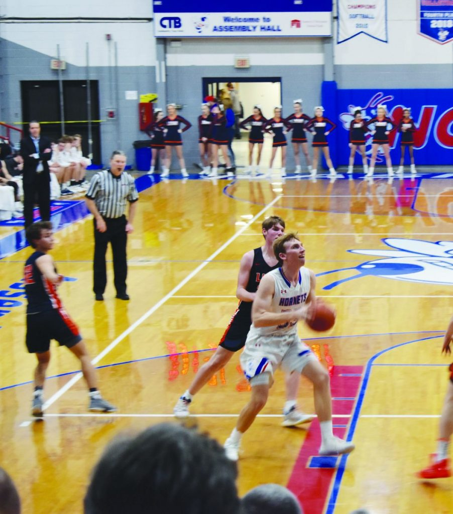 Terry Pelczynski drives the lane in Friday's win against Carterville.